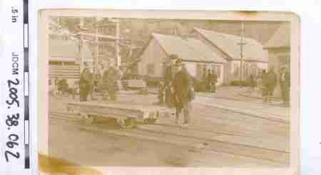 Men on the Boardwalk at the Alaska-Gastineau Mine, Juneau, Alaska , c. 1912. Image courtesy of the Juneau-Douglas City Museum, 2005.38.062.