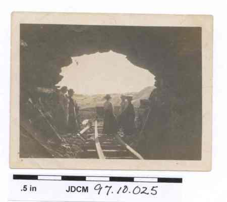 Women in Tunnel Entrance, c. 1912. Image courtesy of the Juneau-Douglas City Museum, 97.10.025.